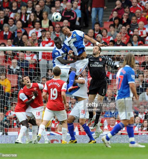 Goalkeeper Manuel Almunia of Arsenal is outjumped by Steven N'Zonzi and Christopher Samba of Blackburn during the Barclays Premiership match between...