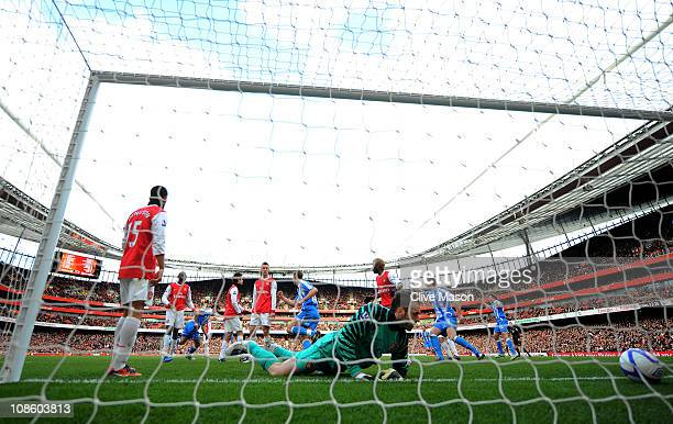 Goalkeeper Manuel Almunia of Arsenal looks on as Alan Lee of Huddersfield celebrates after levelling the scores at 11 during the FA Cup sponsored by...