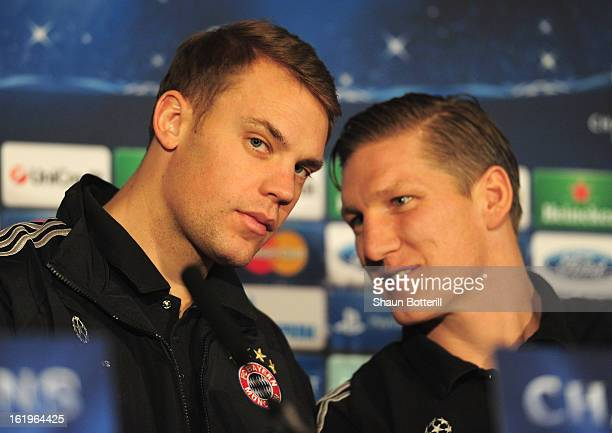 Goalkeeper Manuel Neuer and Bastian Schweinsteiger of FC Bayern Muenchen attend a press conference ahead of their UEFA Champions League round of 16...