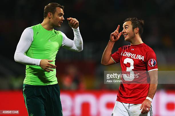 Goalkeeper Manuel Neuer and Mario Goetze of Germany chat after the EURO 2016 Qualifier between Germany and Gibraltar and GrundigStadion on November...