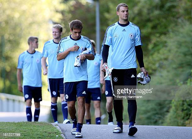 Goalkeeper Manuel Neuer and Philipp Lahm of Germany attend a training session on September 04, 2012 in Barsinghausen, Germany, three days before...