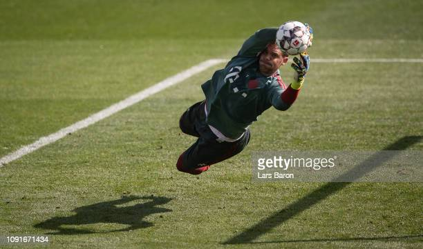 Goalkeeper Manuel Neuer catches the ball during a training session at day six of the Bayern Muenchen training camp at Aspire Academy on January 07...