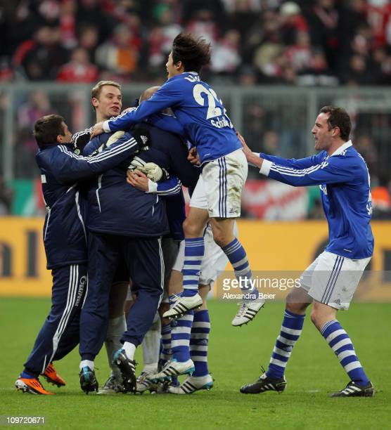 Goalkeeper Manuel Neuer , Christoph Metzelder and Atsuto Uchida and teammates of Schalke celebrate their team's victory of the DFB Cup semi final...