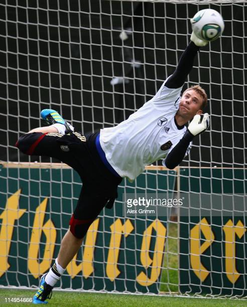 Goalkeeper Manuel Neuer dd jumps for a ball during a training session ahead of their UEFA EURO 2012 qualifying match against Austria on May 31 2011...