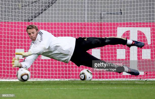 Goalkeeper Manuel Neuer dives for the ball during a German National team training session at the Esprit Arena on May 12, 2010 in Dusseldorf, Germany.