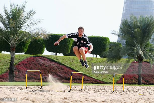 Goalkeeper Manuel Neuer exercises during a Bayern Muenchen training session at the ASPIRE Academy for Sports Excellence on January 9 2013 in Doha...