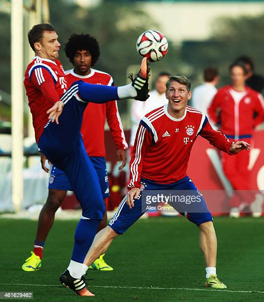 Goalkeeper Manuel Neuer is challenged by Bastian Schweinsteiger during day 8 of the Bayern Muenchen training camp at ASPIRE Academy for Sports...