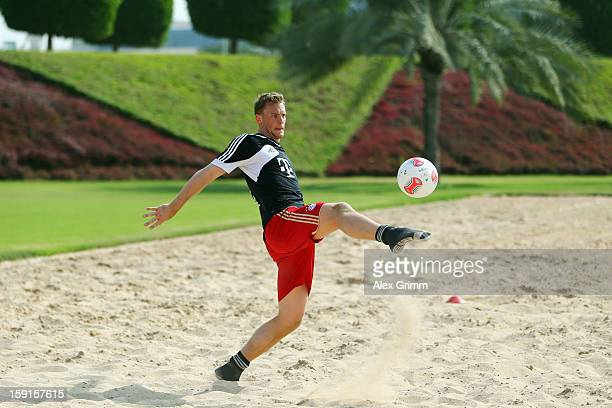 Goalkeeper Manuel Neuer juggles with the ball during a Bayern Muenchen training session at the ASPIRE Academy for Sports Excellence on January 9 2013...