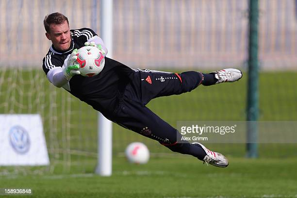 Goalkeeper Manuel Neuer makes a save during a Bayern Muenchen training session at the ASPIRE Academy for Sports Excellence on January 4 2013 in Doha...