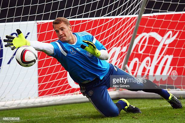 Goalkeeper Manuel Neuer makes a save during a Germany training session at 'Kleine Kampfbahn' training ground on September 2 2015 in Frankfurt am Main...