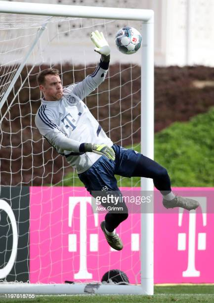 Goalkeeper Manuel Neuer makes a save during a training session at Aspire Zone during day two of the FC Bayern Muenchen winter training camp on...