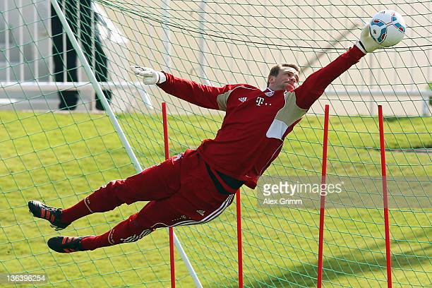 Goalkeeper Manuel Neuer makes a save during a training session of Bayern Muenchen at the ASPIRE Academy for Sports Excellence on January 4 2012 in...