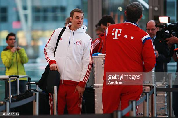Goalkeeper Manuel Neuer of Bayern Muenchen arrives at the airport for the departure to the team's training camp in Doha Qatar on January 9 2015 in...