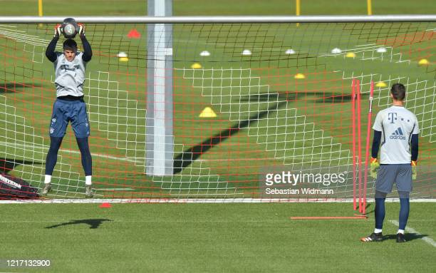 Goalkeeper Manuel Neuer of Bayern Muenchen catches a ball during a training session at Saebener Strasse training ground on April 06 2020 in Munich...