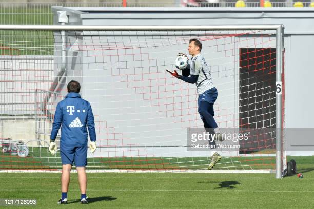 Goalkeeper Manuel Neuer of Bayern Muenchen catches the ball during a training session at Saebener Strasse training ground on April 06 2020 in Munich...