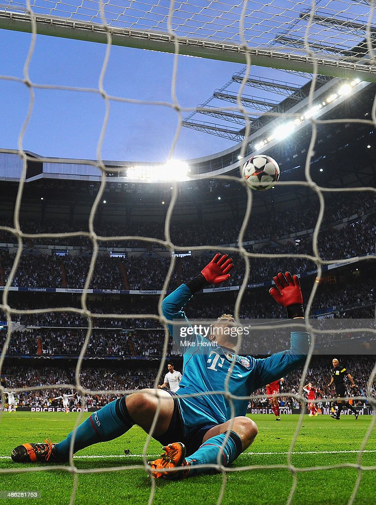 Goalkeeper Manuel Neuer of Bayern Muenchen fails to stop the shot by Karim Benzema of Real Madrid during the UEFA Champions League semi-final first leg match between Real Madrid and FC Bayern Muenchen at the Estadio Santiago Bernabeu on April 23, 2014 in Madrid, Spain.