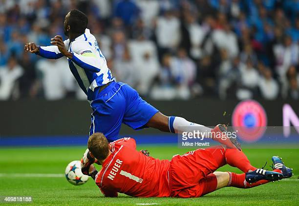 Goalkeeper Manuel Neuer of Bayern Muenchen fouls Jackson Martinez of FC Porto to concede a penalty kick during the UEFA Champions League Quarter...