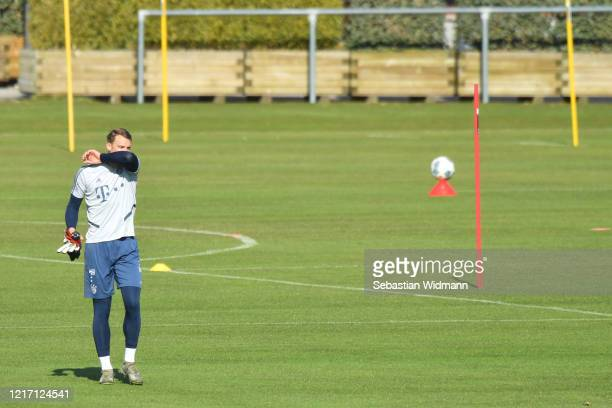Goalkeeper Manuel Neuer of Bayern Muenchen holds his elbow in front of his face during a training session at Saebener Strasse training ground on...