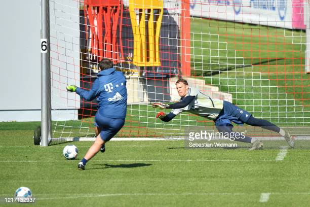 Goalkeeper Manuel Neuer of Bayern Muenchen jumps for a ball during a training session at Saebener Strasse training ground on April 06 2020 in Munich...