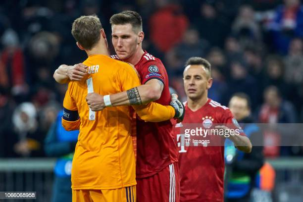 Goalkeeper Manuel Neuer of Bayern Muenchen shakes hands with Niklas Suele of Bayern Muenchen during the Group E match of the UEFA Champions League...