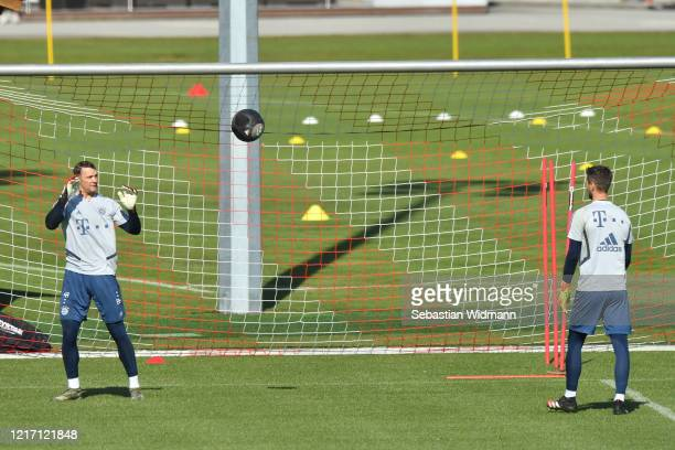Goalkeeper Manuel Neuer of Bayern Muenchen throws the ball to team mate Sven Ulreich during a training session at Saebener Strasse training ground on...