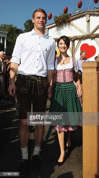 Goalkeeper Manuel Neuer of FC Bayern Muenchen and his girlfriend Katrin attend the Oktoberfest beer festival at the Kaefer Wiesnschaenke tent on...