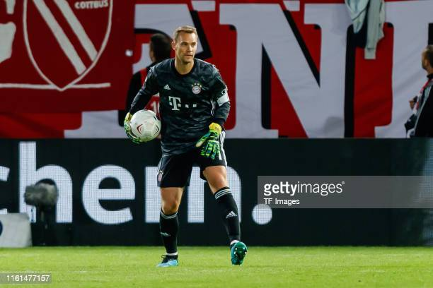 Goalkeeper Manuel Neuer of FC Bayern Muenchen controls the ball during the DFB Cup first round match between Energie Cottbus and FC Bayern Muenchen...