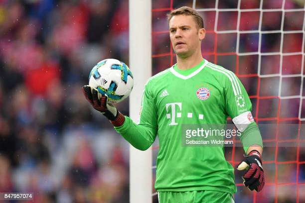 Goalkeeper Manuel Neuer of FC Bayern Muenchen holds the ball during the Bundesliga match between FC Bayern Muenchen and 1 FSV Mainz 05 at Allianz...