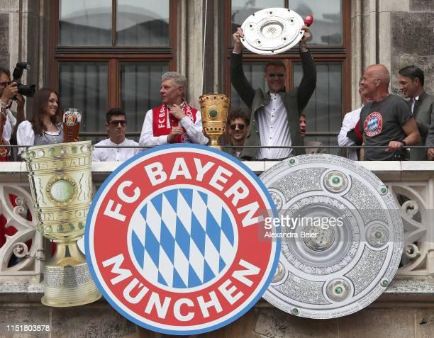 Goalkeeper Manuel Neuer of FC Bayern Muenchen lifts the Bundesliga trophy in celebration winning the Bundesliga title and the German Cup title for...