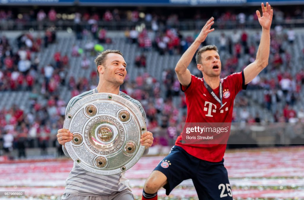 Goalkeeper Manuel Neuer of FC Bayern Muenchen lifts the trophy to celebrate the 28th German football championship after the Bundesliga match between FC Bayern Muenchen and VfB Stuttgart at Allianz Arena on May 12, 2018 in Munich, Germany.