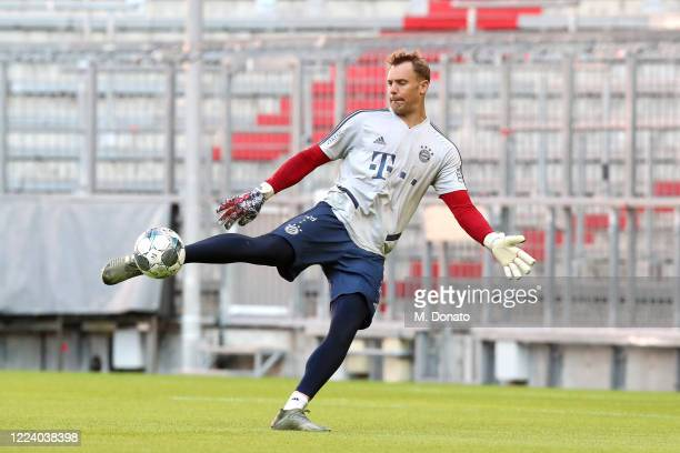 Goalkeeper Manuel Neuer of FC Bayern Muenchen plays the ball during a training session at Allianz Arena on May 10, 2020 in Munich, Germany. FC Bayern...