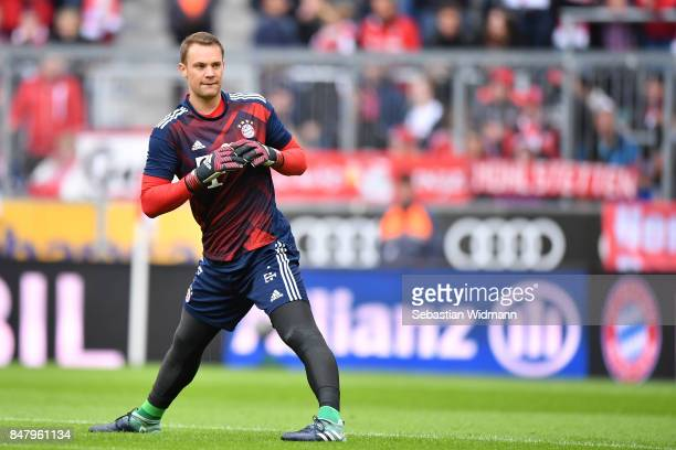 Goalkeeper Manuel Neuer of FC Bayern Muenchen stretches before the Bundesliga match between FC Bayern Muenchen and 1 FSV Mainz 05 at Allianz Arena on...