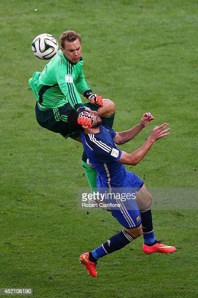 Goalkeeper Manuel Neuer of Germany collides with Gonzalo Higuain of Argentina during the 2014 FIFA World Cup Brazil Final match between Germany and...