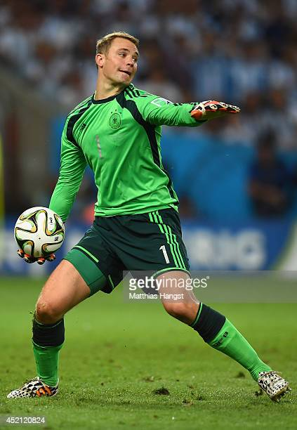 Goalkeeper Manuel Neuer of Germany controls the ball during the 2014 FIFA World Cup Brazil Final match between Germany and Argentina at Maracana on...
