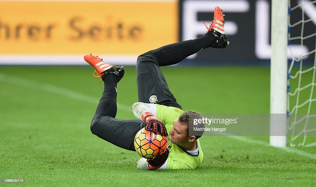 Goalkeeper Manuel Neuer of Germany jumps for a ball during a Germany training session ahead of their International Friendly against France at Stade de France on November 12, 2015 in Paris, France.