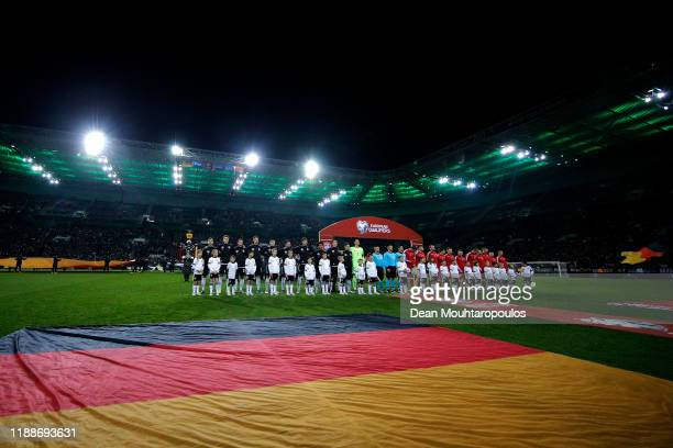 Goalkeeper Manuel Neuer of Germany leads the team for the national anthem prior to the UEFA Euro 2020 Qualifier between Germany and Belarus on...