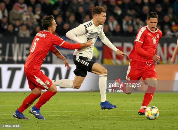 Goalkeeper Manuel Neuer of Germany Nemanja Maksimovic of Serbia and Sasa Lukic of Serbia battle for the ball during the International Friendly match...