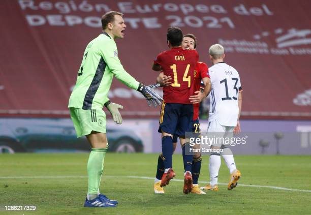 Goalkeeper Manuel Neuer of Germany reacts as Mikel Oyarzabal of Spain celebrates his team's sixth goal with teammate Jose Gaya during the UEFA...