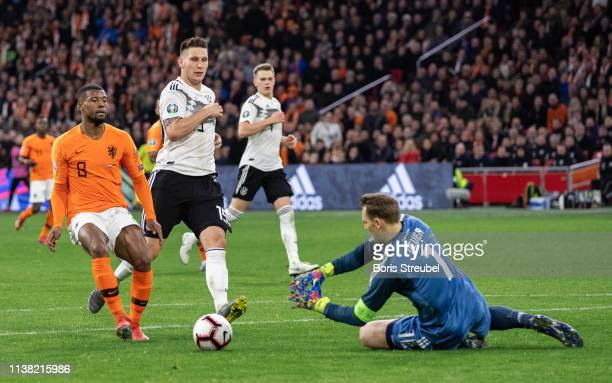 Goalkeeper Manuel Neuer of Germany saves a ball of Georginio Wijnaldum of the Netherlands during the 2020 UEFA European Championships group C...