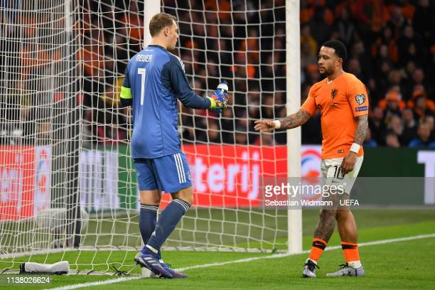 Goalkeeper Manuel Neuer of Germany shares his water bottle with Memphis Depay of Netherlands during the 2020 UEFA European Championships group C...