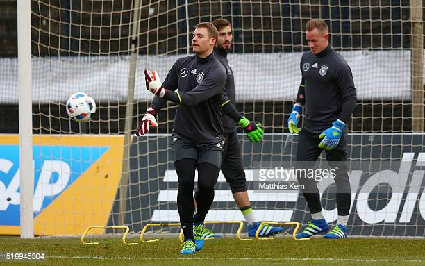 Goalkeeper Manuel Neuer of Germany throws the ball during a Germany training session ahead of their International frindly match against England at...