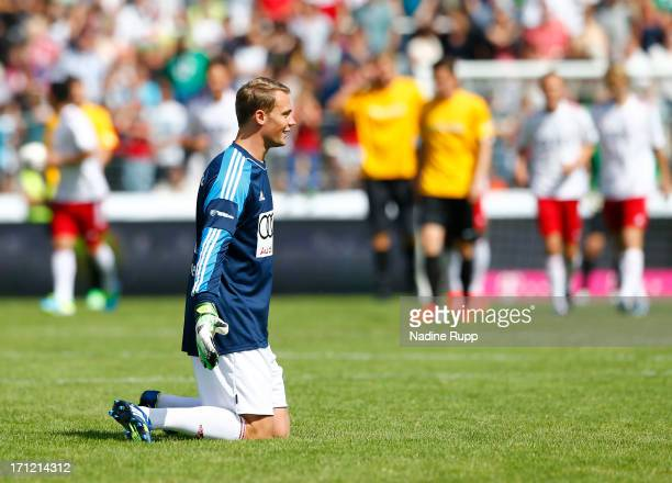 Goalkeeper Manuel Neuer of Manuel Neuer Friends team reacts during the Football Meets Culture Charity Match at Flyeralarm Arena on June 23 2013 in...