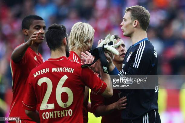Goalkeeper Manuel Neuer of Muenchen celebrates with team mates after winning the penalty shootout during the LIGA total Cup 3rd place match between...
