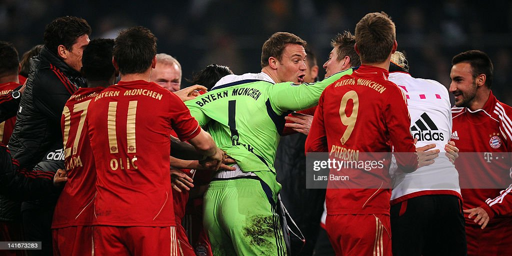 Goalkeeper Manuel Neuer of Muenchen celebrates with team mates after saving the last penalty of Halvard Nordtveit of Moenchengladbach (L) during the DFB Cup semi final match between Borussia Moenchengladbach and FC Bayern Muenchen at Borussia Park Stadium on March 21, 2012 in Moenchengladbach, Germany.