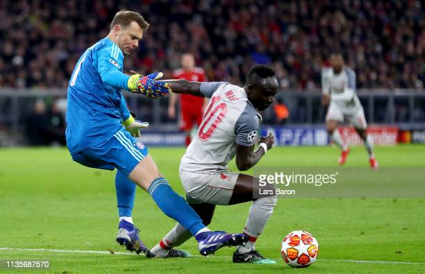 Goalkeeper Manuel Neuer of Muenchen challenges Sadio Mane of Liverpool during the UEFA Champions League Round of 16 Second Leg match between FC...