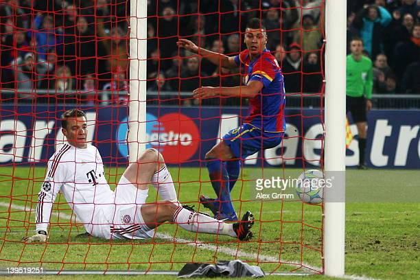 Goalkeeper Manuel Neuer of Muenchen makes a save against Aleksandar Dragovic of Basel during the UEFA Champions League Round of 16 first leg match...