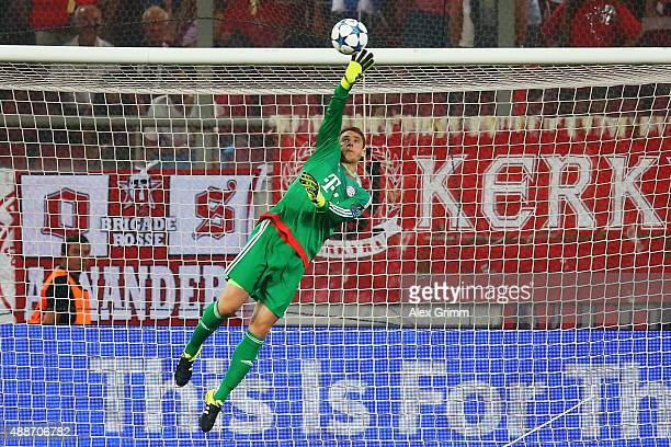 Goalkeeper Manuel Neuer of Muenchen makes a save during the UEFA Champions League Group F match between Olympiacos FC and FC Bayern Muenchen at...