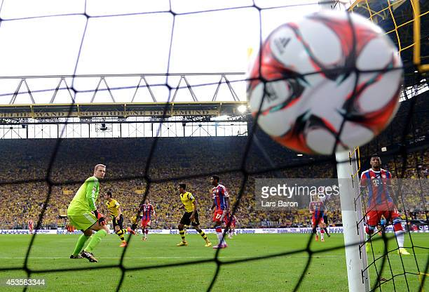 Goalkeeper Manuel Neuer of Munich looks on as Henrikh Mkhitaryan of Dortmund scores the opening goal during the DFL Supercup between Borrussia...