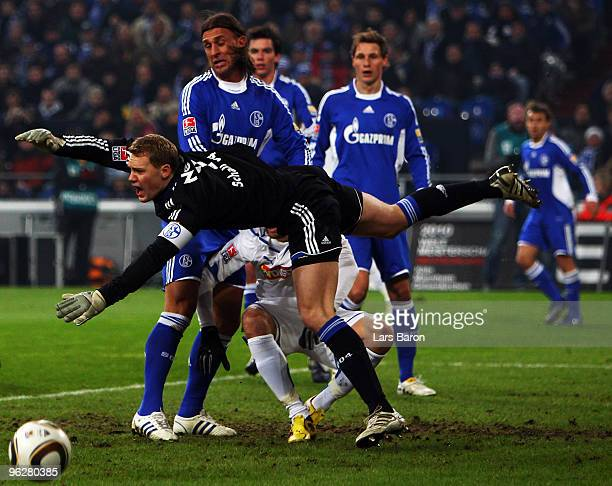 Goalkeeper Manuel Neuer of Schalke jumps over Vedad Ibisevic of Hoffenheim during the Bundesliga match between FC Schalke 04 and 1899 Hoffenheim at...