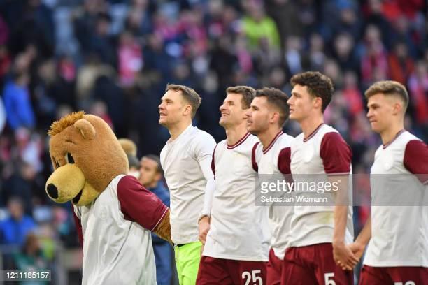 Goalkeeper Manuel Neuer Thomas Mueller Lucas Hernandez Benjamin Pavard and Joshua Kimmich of Bayern Muenchen celebrate after the Bundesliga match...